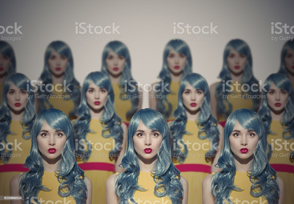 Many Glamour Beauty Woman Clones. Identical Crowd Concept. stock photo