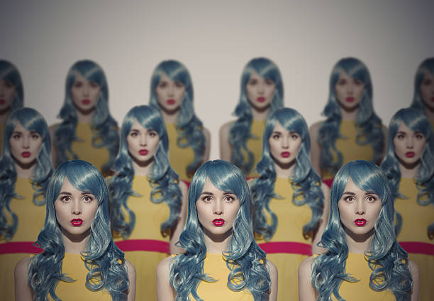 Many Glamour Beauty Woman Clones. Identical Crowd Concept. Many Glamour Beauty Woman Clones. Identical Crowd Concept. On Gray Background. imitation stock pictures, royalty-free photos & images