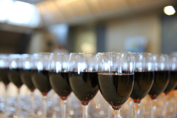 Many glasses of red wine stock photo