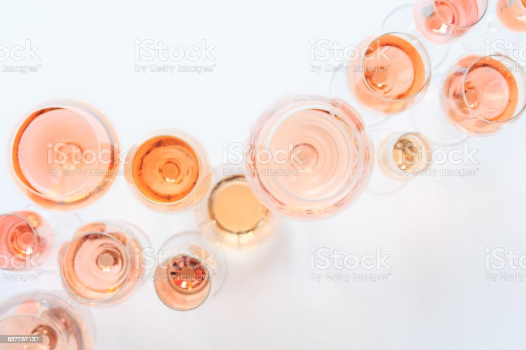 Many glasses of rose wine at wine tasting. Concept of rose wine and variety royalty-free stock photo