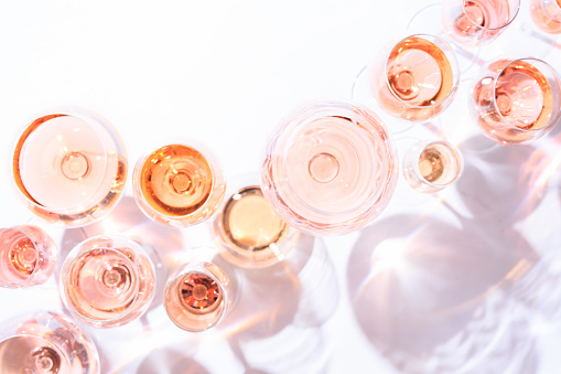 istock Many glasses of rose wine at wine tasting. Concept of rose wine and variety 657287138