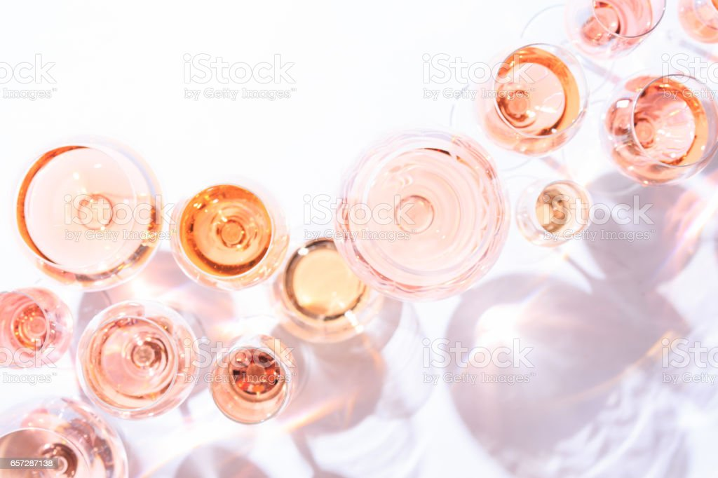 Many glasses of rose wine at wine tasting. Concept of rose wine and variety stock photo