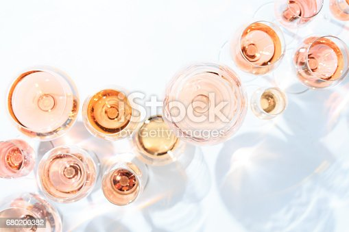 istock Many glasses of rose wine at wine tasting. Concept of rose wine and variety 680200382