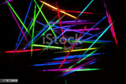 many glow stick shinny with dark background
