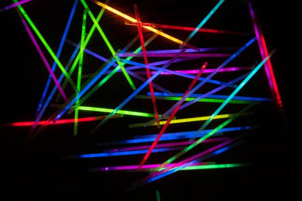 many glow stick shinny with dark background stock photo