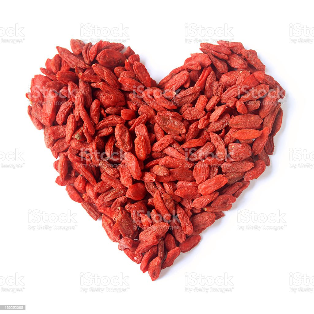 Many goji Berries in the shape of a heart stock photo