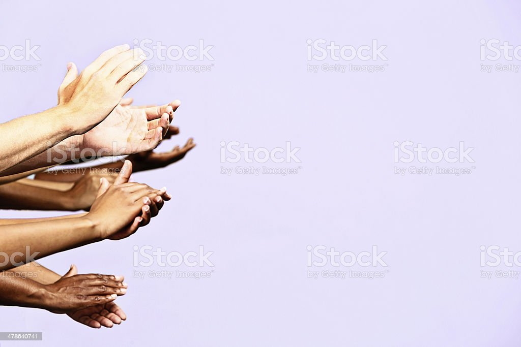 Many hands applauding next to blank space for your message royalty-free stock photo