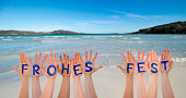 istock Many Hands Building Frohes Fest Means Merry Christmas, Beach And Ocean 1070265558