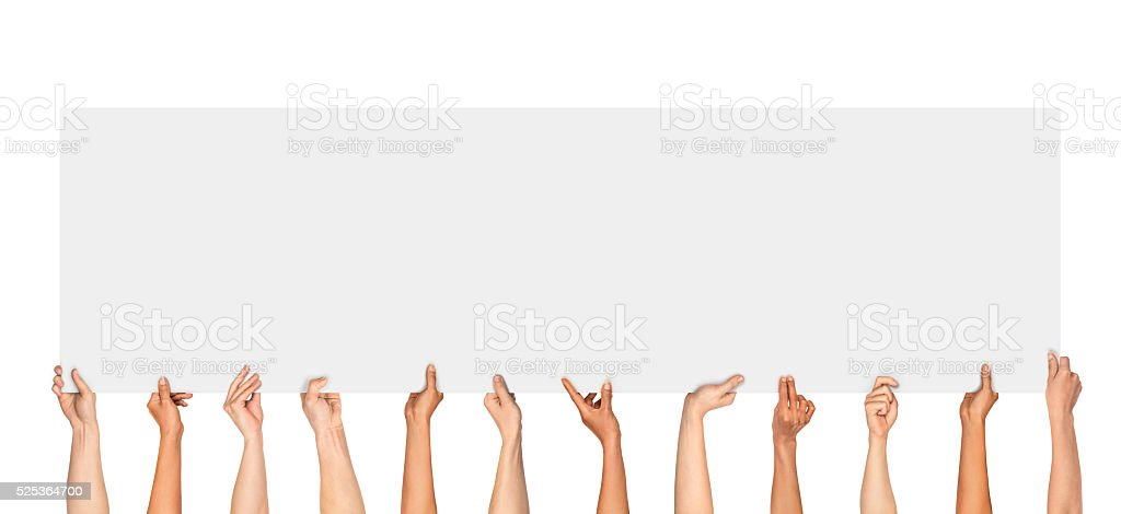 Many hands holding a blank poster stock photo