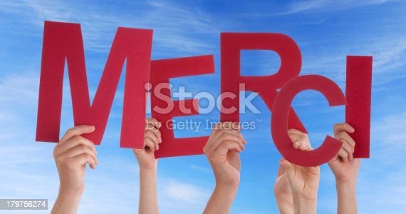 istock Many Hands Holding a Red merci 179756274