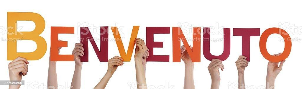 Many Hands Holding Benvenuto stock photo