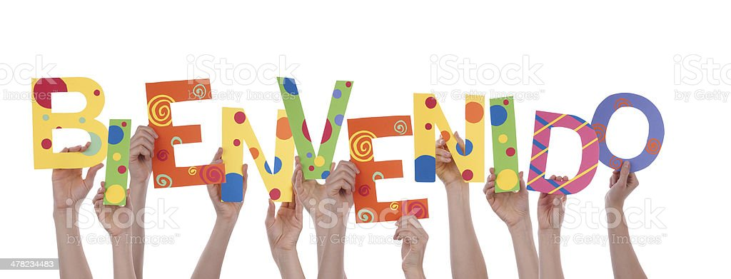 Many Hands Holding Bienvenido stock photo