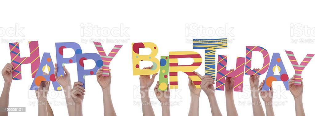 Many hands holding up letters that spell HAPPY BIRTHDAY stock photo