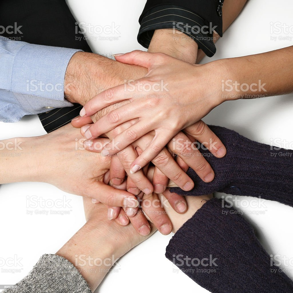 Many hands on top of each other on a white background royalty-free stock photo