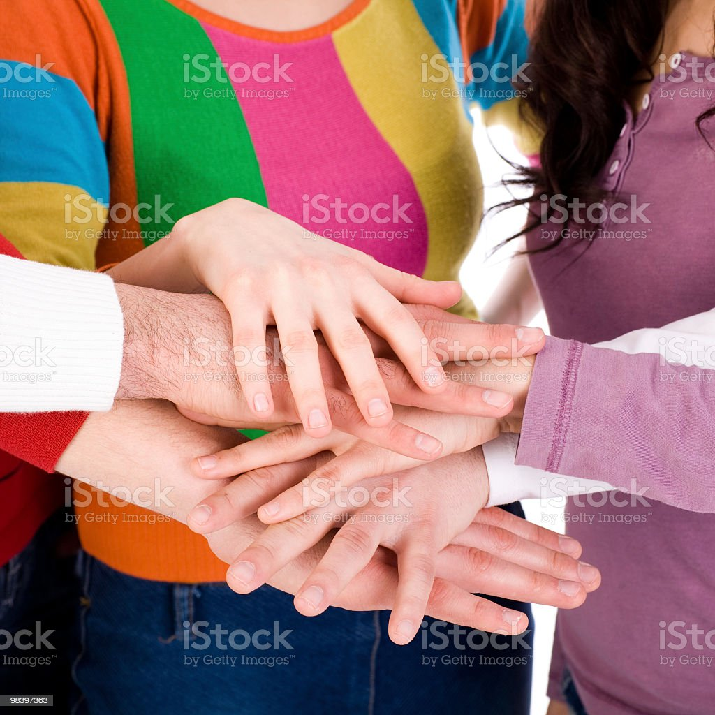 Many hands on top of each other royalty-free stock photo