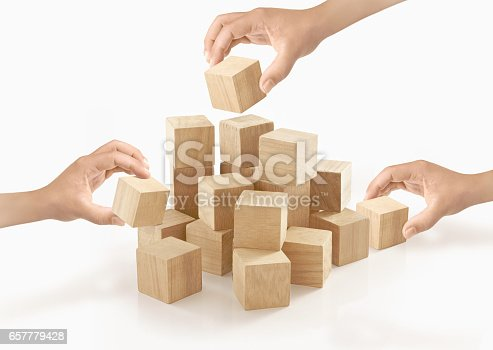 657779378 istock photo Many hands playing wooden box on isolated background. 657779428