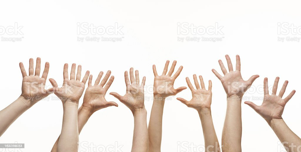 Many hands reaching out in the air royalty-free stock photo