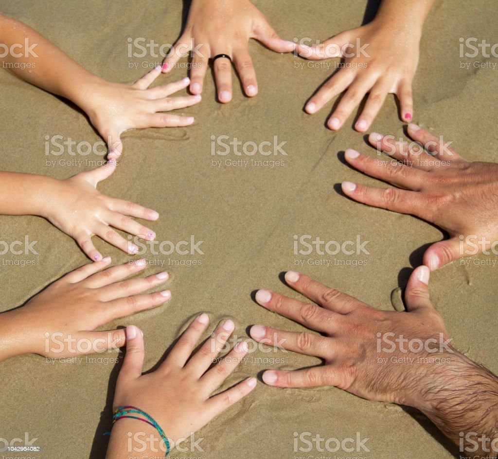 Many hands together stock photo