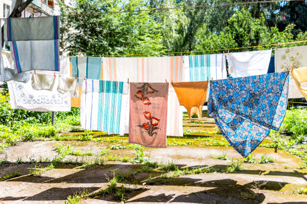 Many hanging clothes in summer garden with colorful shirts drying on picture id1091892536?b=1&k=6&m=1091892536&s=612x612&w=0&h=mzp7ar4gd s17arrumiwzsm99wnv 56nqb8cerxyw 4=