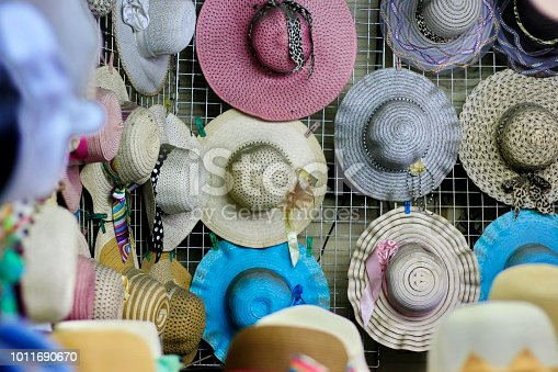 Many hats are in a shop in Thailand.