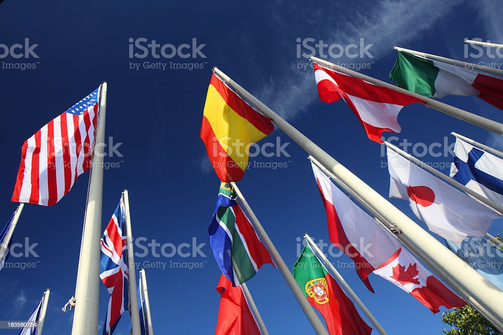 Many international flags on a pole royalty-free stock photo