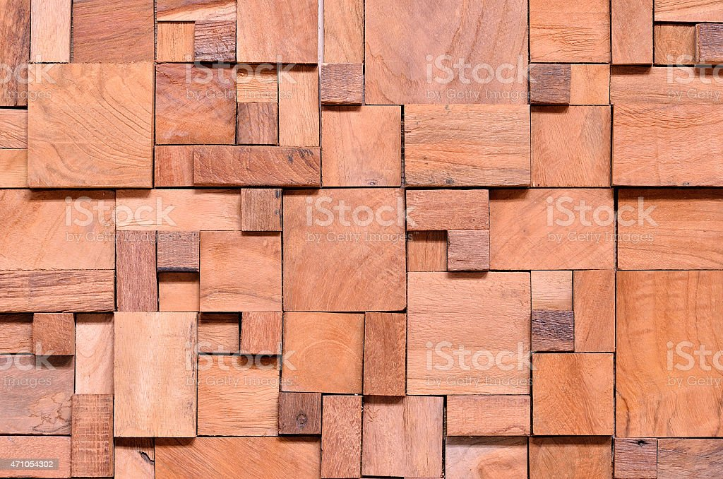 Many irregularly shaped wooden blocks as a background stock photo