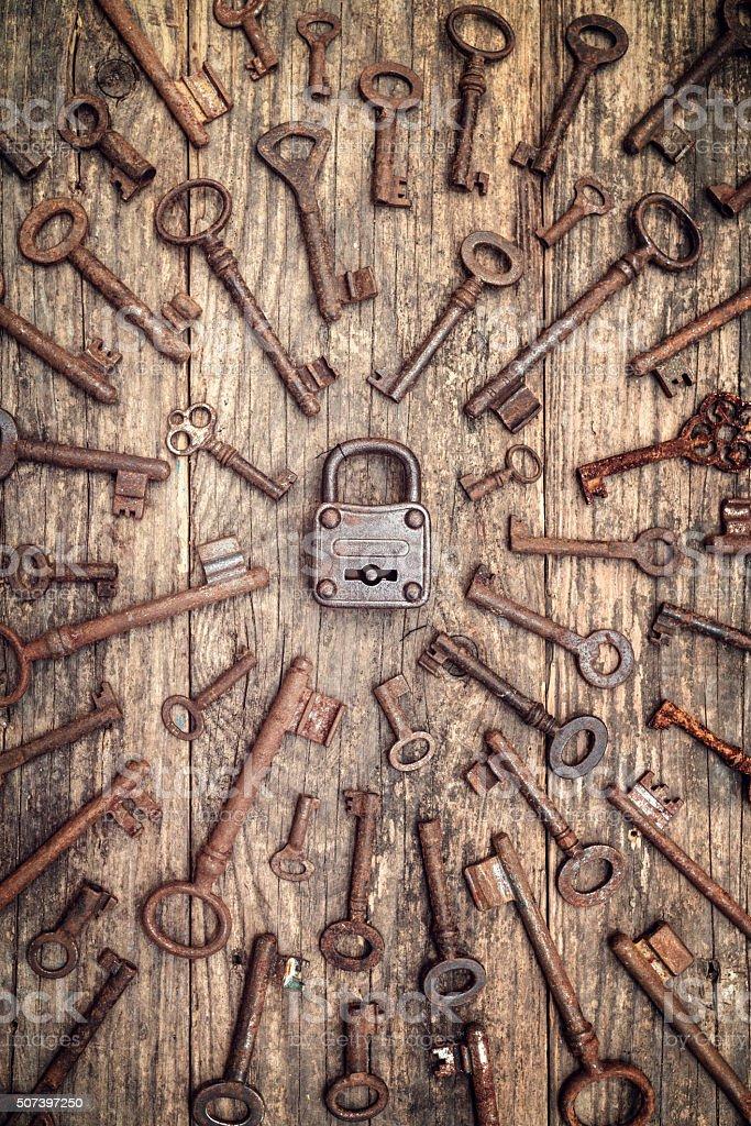 many keys on wood with padlock stock photo