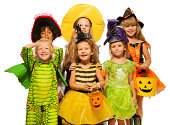 istock Many kids in Halloween costumes, boys and girls 513468439