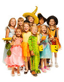 istock Many kids stand in Halloween costumes together 513450217