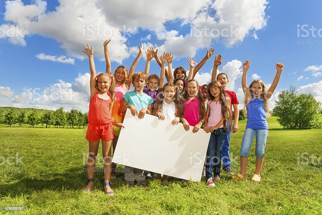 Many kids with white board stock photo