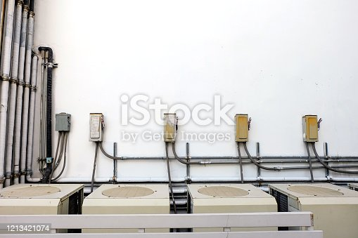 1132460292 istock photo Many large air conditioning systems are outside the building or office. 1213421074
