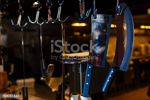 839034546istockphoto Many large knife hanging wooden storage in the kitchen of restaurant 938261442