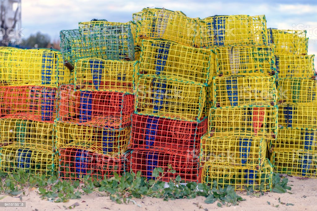 Many loster and squid traps on the beach. stock photo