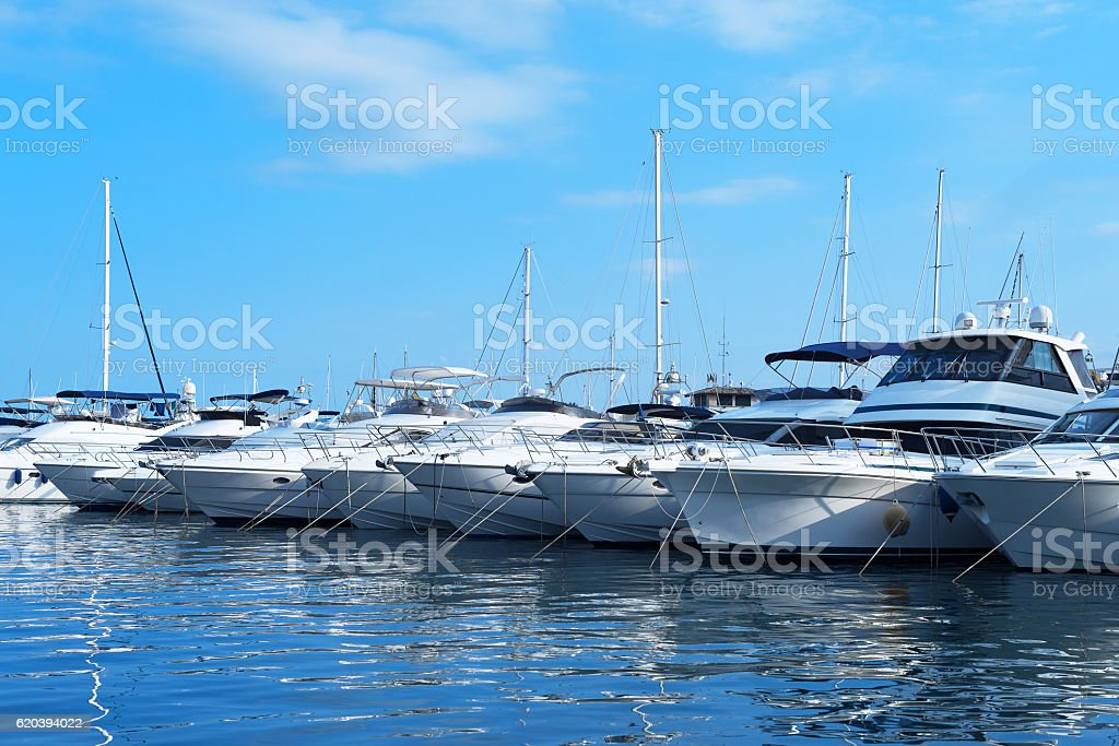 Many luxury yachts and boats in the harbor. stock photo