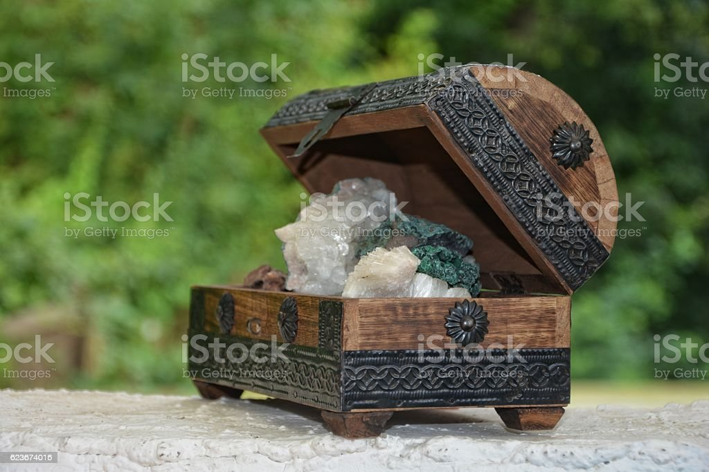 many minerals quartz and crystal stones in wooden box stock photo