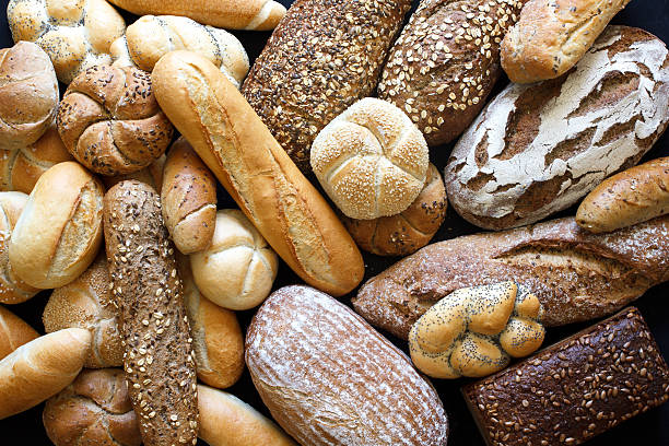 many mixed breads and rolls shot from above. - bakery stockfoto's en -beelden