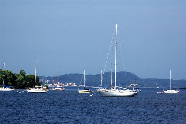 Many moored boats near shore stock photo