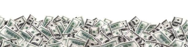 viele viel geld auf weißem hintergrund. breites bild - haufen stock-fotos und bilder