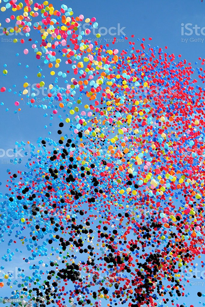 Many multi colored party balloons against the blue sky. Celebration. stock photo