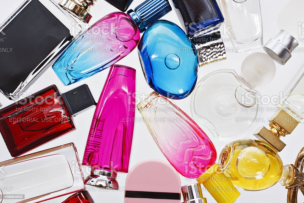 Many multi-colored miniature perfume bottle shot from overhead stock photo