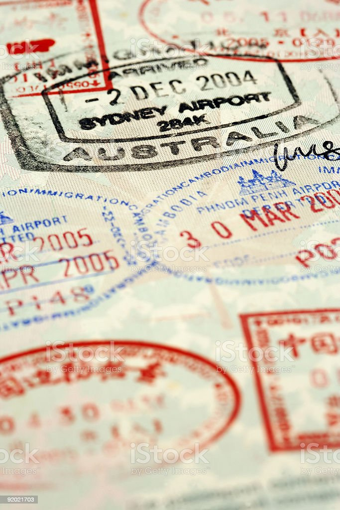 Many multicolored passport stamps with different dates royalty-free stock photo