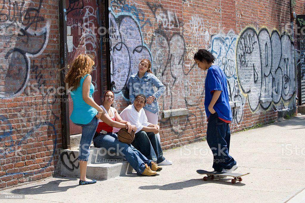 Many neighborhood children sitting on a stoop stock photo
