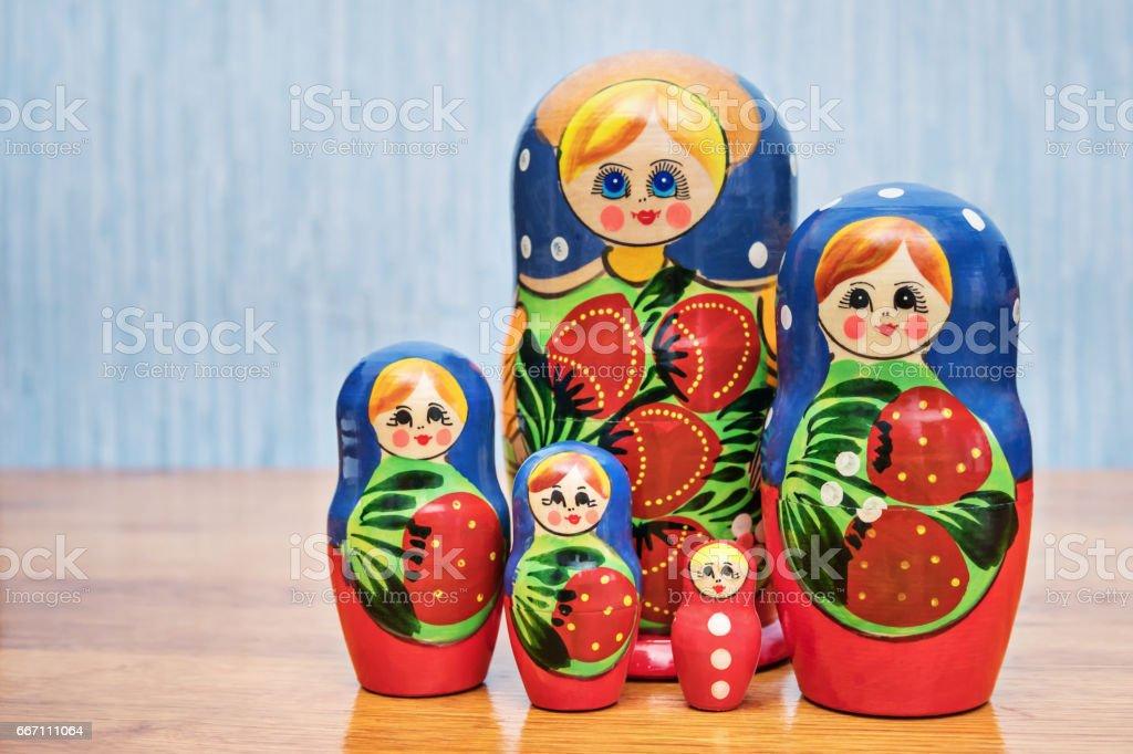 Many nesting dolls on the table stock photo