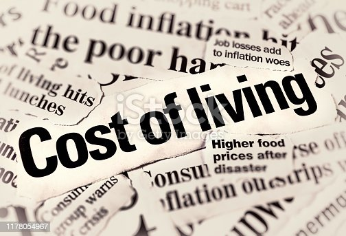 A stack of varied newspaper headlines all covering aspects of the cost of living and inflation.