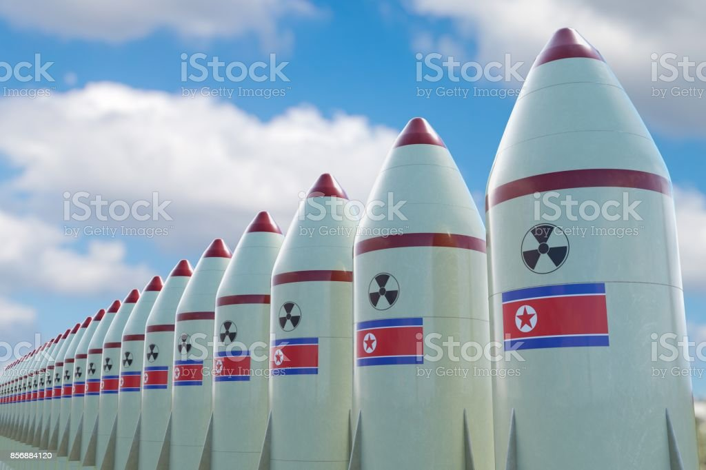 Many nuclear missiles with North Korean flag. 3D rendered illustration. stock photo