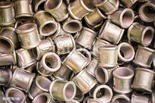 istock Many of connecting fittings for metal pipes. Passivation of the casting surface. 642578748