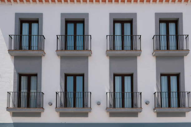 Many of identical balconies on new modern building stock photo