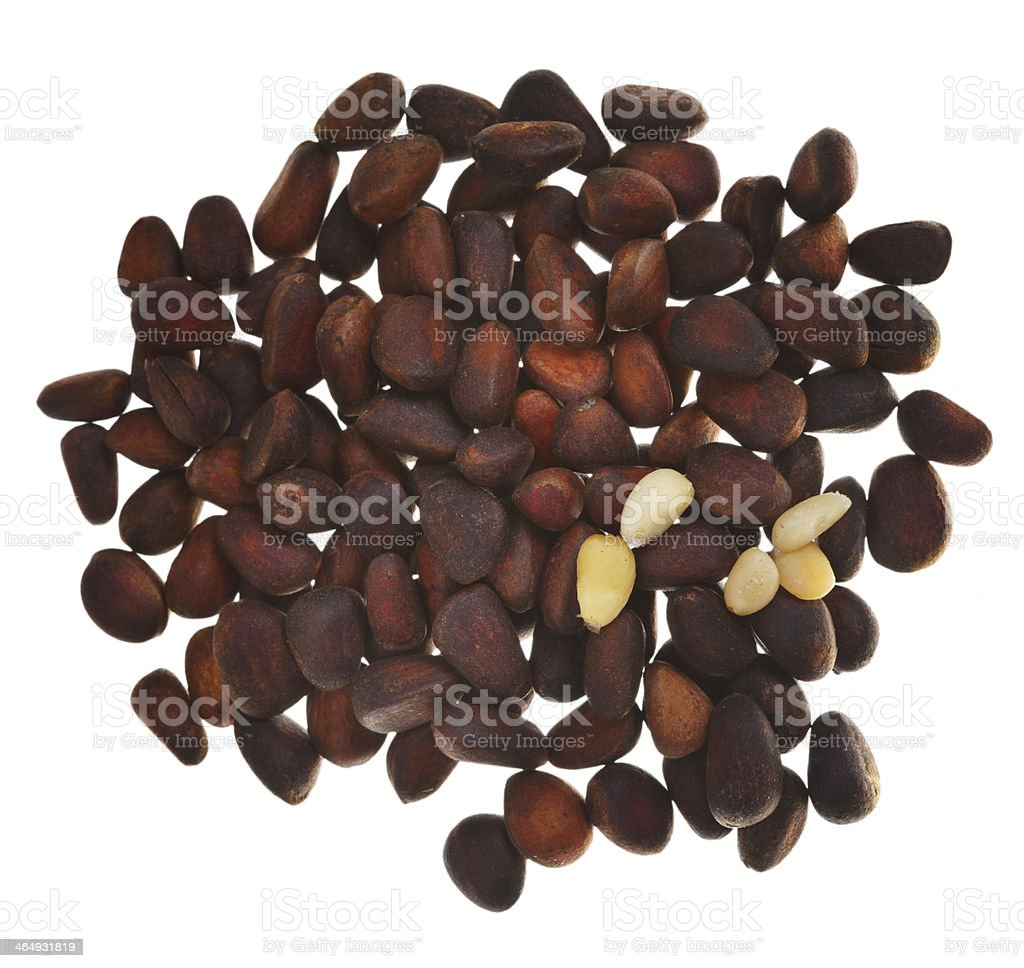 many of pine nuts isolated stock photo