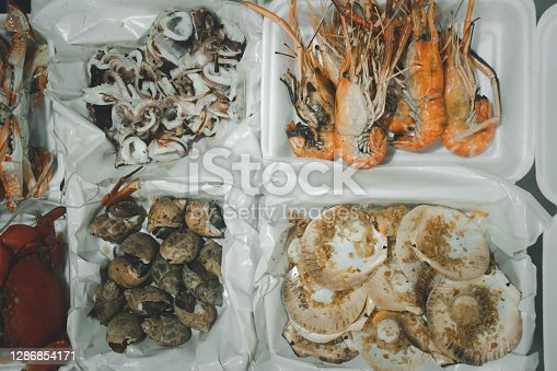 Many of seafood in foam box ready to eat for picnic and party