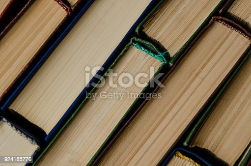 istock Many old books, top view, like background 924185776